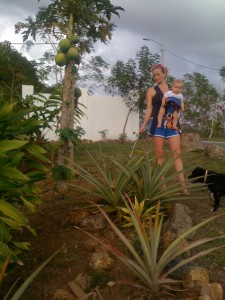 Summer and Sydney Watering the Pineapple Plants